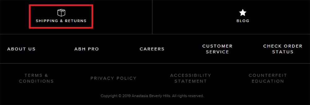 Anastasia Beverly Hills website footer with Shipping and Returns Policy link highlighted